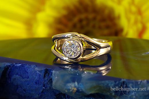 Diamond in charmed ring